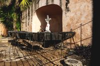 Jesus statue with candle holders at the Convent de San Bernardino de Siena, Valladolid, Mexico