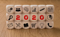 Dice with icons and the Year 2020