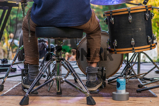 Legs of a drummer on stage at festival