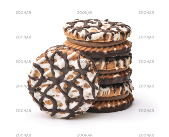 Stack of frosting drizzled round cookie