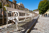 Bench on the banks of the river Tepla in the old town of Karlovy Vary in the Czech Republic