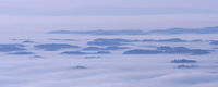 Elevations from a sea of fog over Lake Constance
