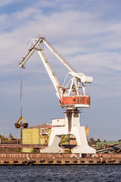 Working cranes unload cargo