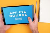 person participating in online course on tablet computer