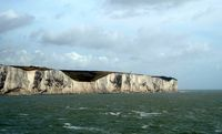 white cliffs of dover grass clear sky sea england