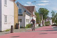 People walking through traditional streets of Stavanger in Norway