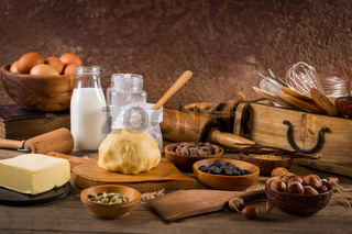 Assortment of baking ingredients and kitchen utensils in vintage wooden style. Christmas baking concept.