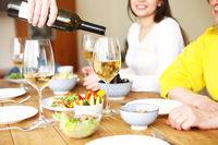 Man serving wine during dinner