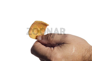 Male hand with a snack