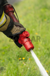 Firefighter Fire Department of Federal Fire Service in Kamchatka during fire extinguishing, training to overcome fire zone of psychological training for firefighters