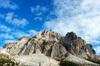View of the beautiful Dolomites mountains in Italy against the background of blue sky.