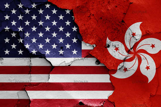flags of USA and Hong Kong painted on cracked wall