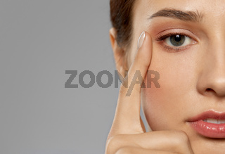 close up of beautiful young woman face and eyes