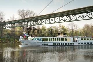 Vltava river cruise boat on way to Prague  under bridge