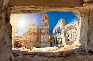 Ancien old Roman queen Jelena square and cathedral in Split view through stone window