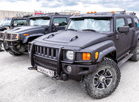 Black luxury Hummer cars parking at the city street