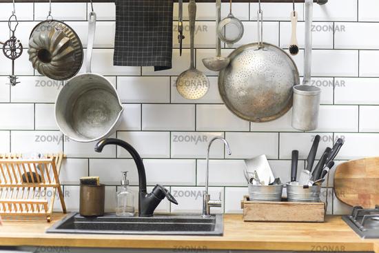 Retro kitchenware around sink at home