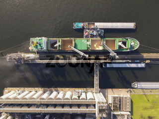 Loading of a docked ship in a industrial harbour