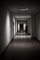 empty long corridor stretching into the future. The concept of holidays, quarantine, evacuation in the modern office building.