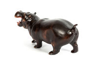 wooden figure of a hippopotamus isolated on background.