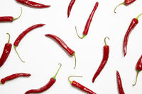 Red hot chilli peppers on white background. flat lay, top view