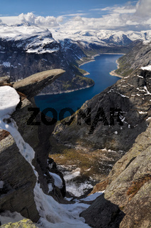 View of Trolltunga and the valley underneath from the distance