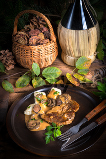 Steak with potato dumplings and forest mushroom sauce