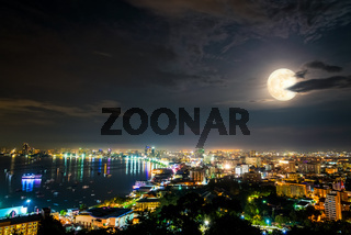 Full moon above Pattaya City at night, Thailand