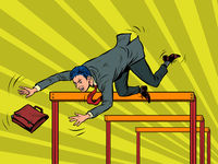 Businessman falling from a barrier