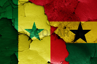 flags of Senegal and Ghana painted on cracked wall