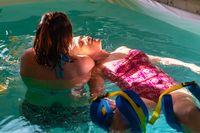 Therapist giving massage to senior woman
