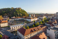Aerial drone panoramic view of Ljubljana medieval city center, capital of Slovenia in warm afternoon sun. Empty streets during corona virus pandemic social distancing measures
