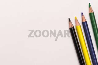 Colour pencils lay on white background