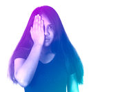 Diverse Asian woman holding hand in front of one eye with duotone gradient filter effect - Mixed race millennial girl covering eyes isolated on white background - Abuse, accident and protest concept