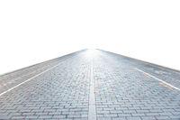Brick road on empty city street