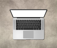 Open laptop top view with blank screen on concrete desk. 3D render