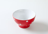 Empty red and white polka dot bowl