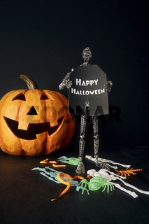 Metal mannequin holding sign with pumpkin