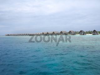 Water villas in vivid clear sea water