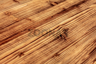 Detail on wooden boards, grain of wood  enhanced by burning.