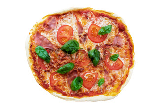 pizza with serrano ham, sliced tomatoes and basil isolated on white