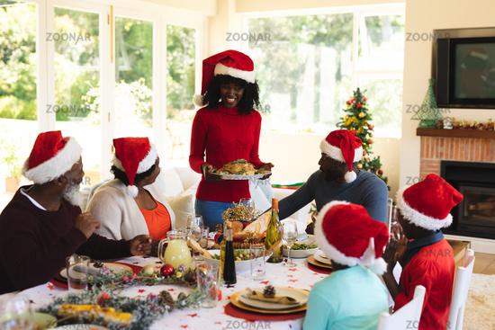 Multigeneration family having christmas dinner together