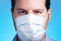 Man wearing a respiratory face mask. Medical safety, research and corona virus concept.