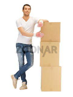 handsome man with big boxes
