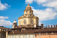 Perspective on the elegant Saint Lawrence church in Turin with a blue sky