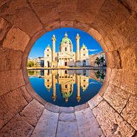 Vienna. Karlskirche church of Vienna reflection view through stone window