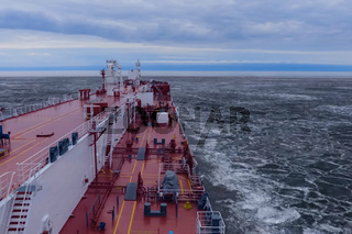 feed of a ship sailing in the Arctic. Landscape of the Arctic from the deck of the tanker.
