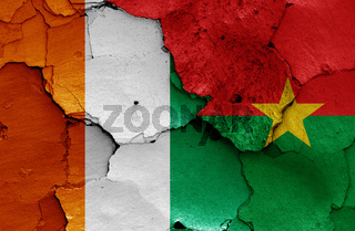flags of Ivory Coast and Burkina Faso painted on cracked wall