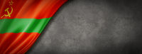 Transnistria flag on concrete wall banner