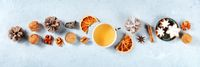 Flat lay Christmas panorama. Tea, cookies, spices, dried fruit, cozy handmade layout for a sustainable winter holidays banner